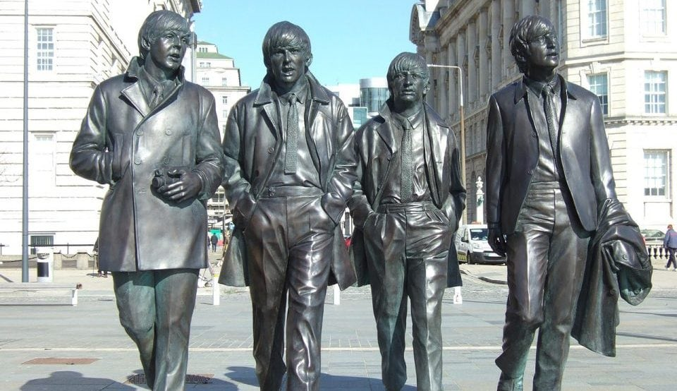 A picture of the Beatles statues at Liveprool pier head